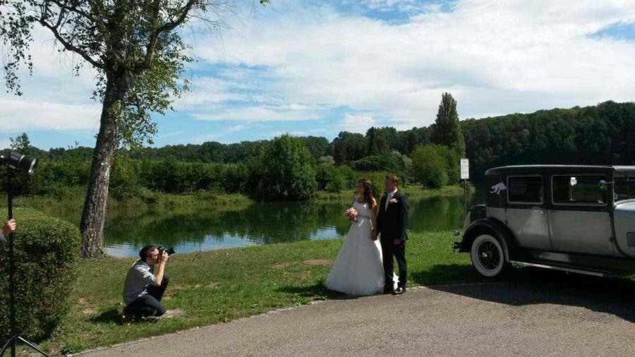 Hinter den Kulissenfoto vom Brautpaarfotoshooting mit Fotograf bei der Musikinsel Rheinau
